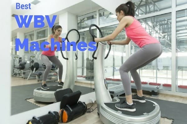 Women standing on a WBV machine in a gym
