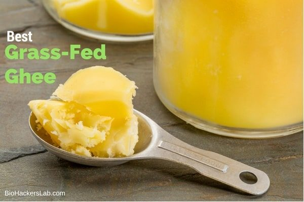 Bottle of ghee and spoon with ghee on it