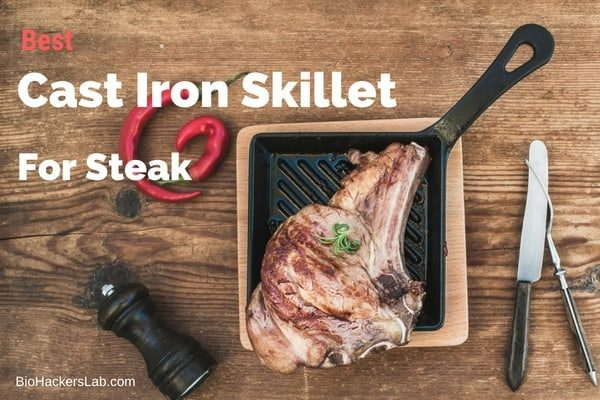 Square cast iron skillet with a piece of t-bone steak on it and knife and fork around it