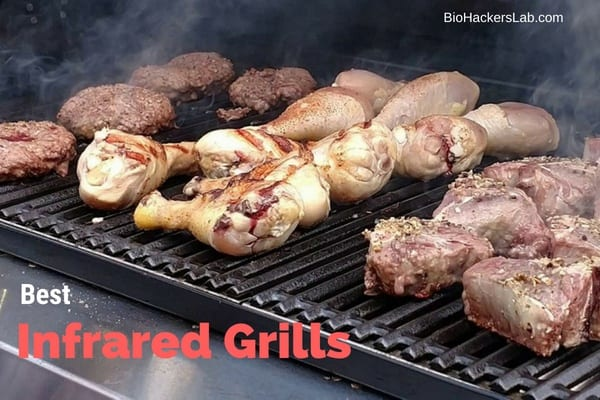 Beef, chicken and burgers cooking on an outdoor grill