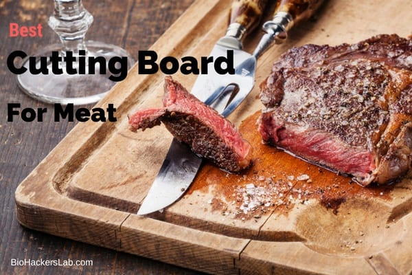 Wooden cutting board with sliced cooked steak on it