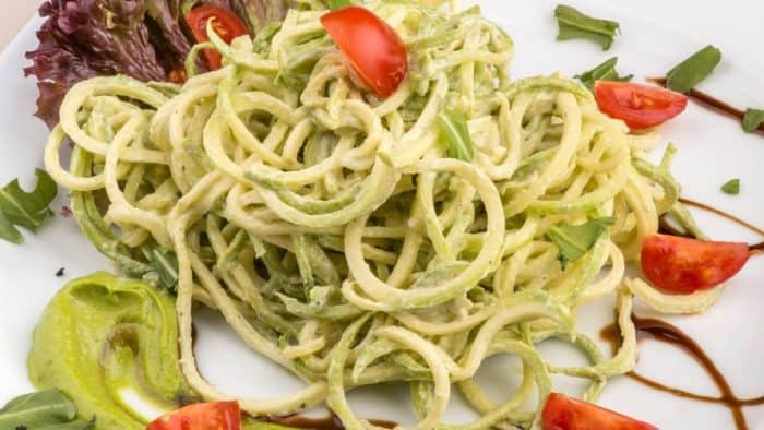Creamy spiralized zucchini on a plate