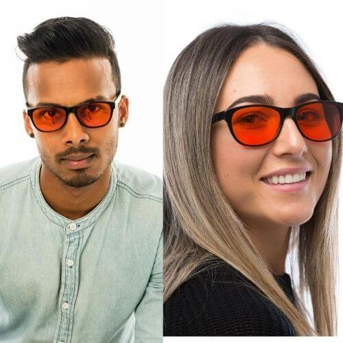 Man and woman wearing a pair of red lens blublox wayfair style blue blocking glasses